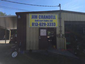 Large outdoor sign for Jim Crandell Golf Cart Sales in Zephyrhills, FL