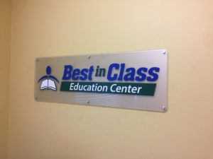 Lobby Sign, cut vinyl over frosted acrylic.