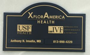 Exterior routed (sandblasted) outdoor custom sign for Xplor America. Sign has two removable plaques.